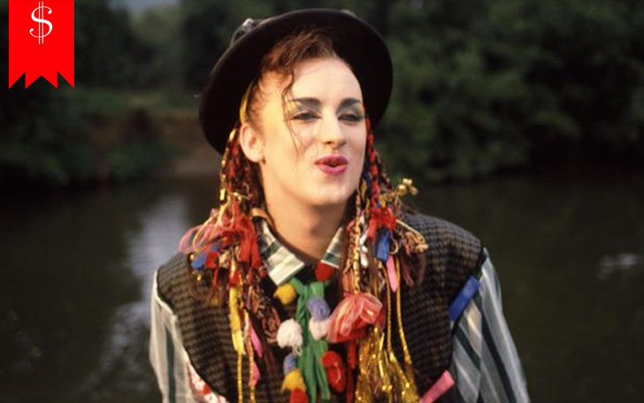 Singer Boy George's estimated net worth is $35 million. Find out about his luxury cars and houses.