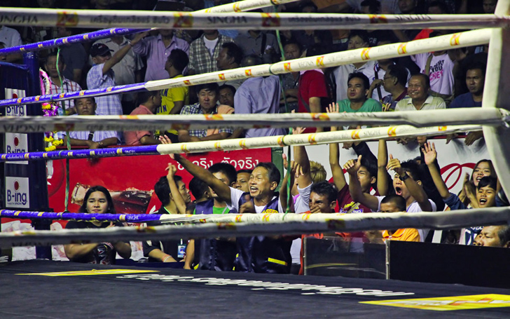 Fans Rushed To Beat a Kickboxer in the Ring After He Knocked Down the Opponent