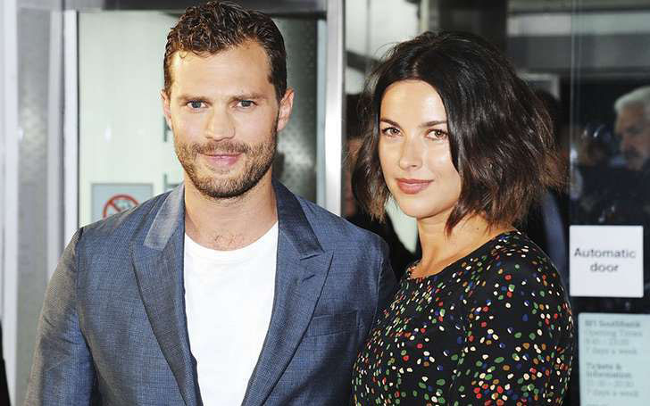 Fifty Shades Franchise actor Jamie Dornan and wife Amelia Warner dragged into rumors of divorce but they are just hoax; The pair still happily married