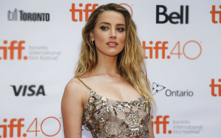 Amber Heard True To Her Word Donating Over $1 Million From Divorce Settlement With Johnny Depp To Charity