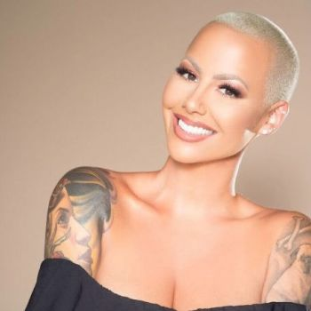Amber Rose Flaunts Her Growing Baby Bump