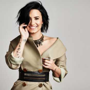 Singer Demi Lovato goes topless for a steamy photoshoot for her the promo of her new song